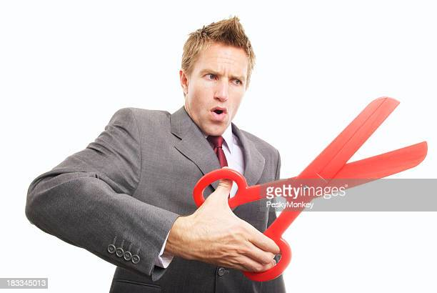 Businessman Cutting with Big Pair of Red Scissors Snip
