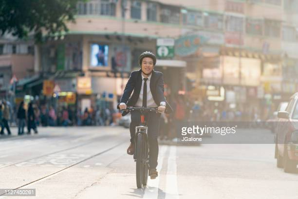 Businessman cycling through the city on a bicycle