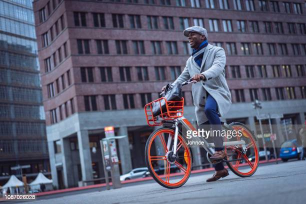 businessman cycling to the work - wide shot stock pictures, royalty-free photos & images