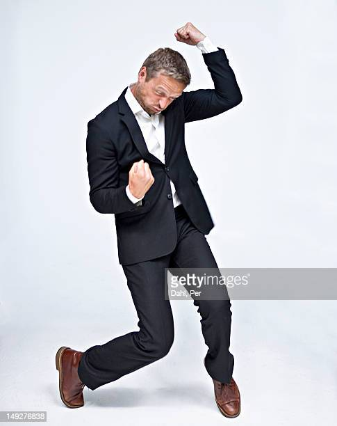 Businessman dancing and punching air