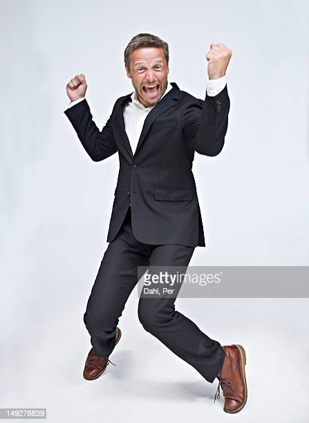 Businessman dancing and screaming