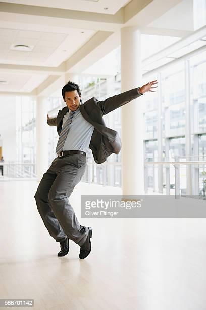 Businessman dancing in corridor