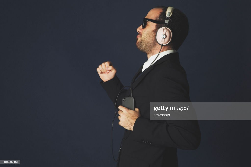 Businessman dancing in the studio : Stock Photo