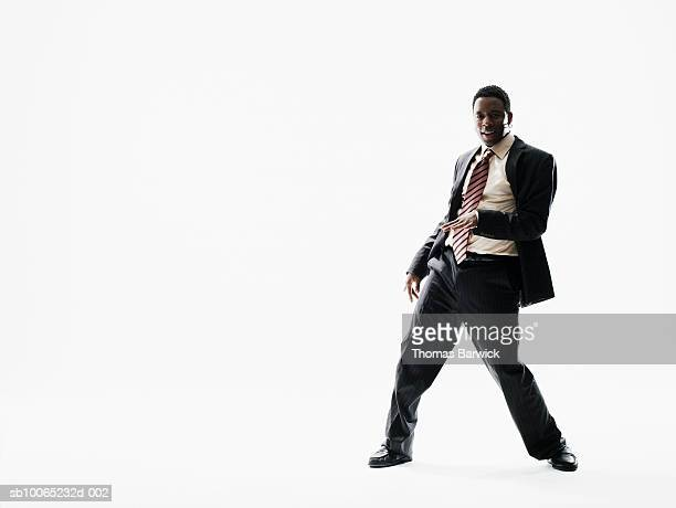 Businessman dancing on white background