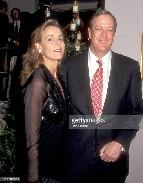 Businessman David H Koch and guest Julia Flesher attend An Evening of Fashion by Celine Benefit for Gods Love We Deliver on May 23 1995 at City...
