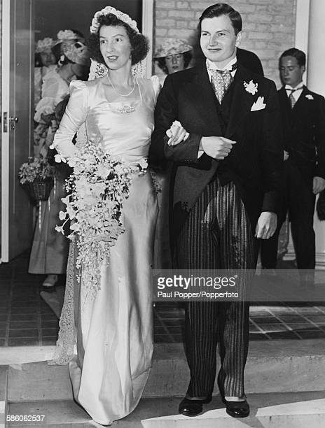 Businessman David Rockefeller the youngest son of financier John D Rockefeller Jr with his bride Margaret McGrath leave St Matthew's Church New York...