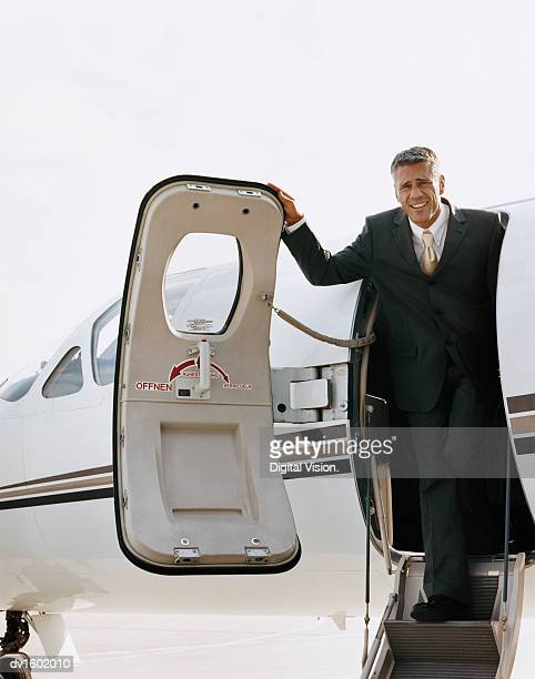 A Businessman Descending From a Corporate Jet