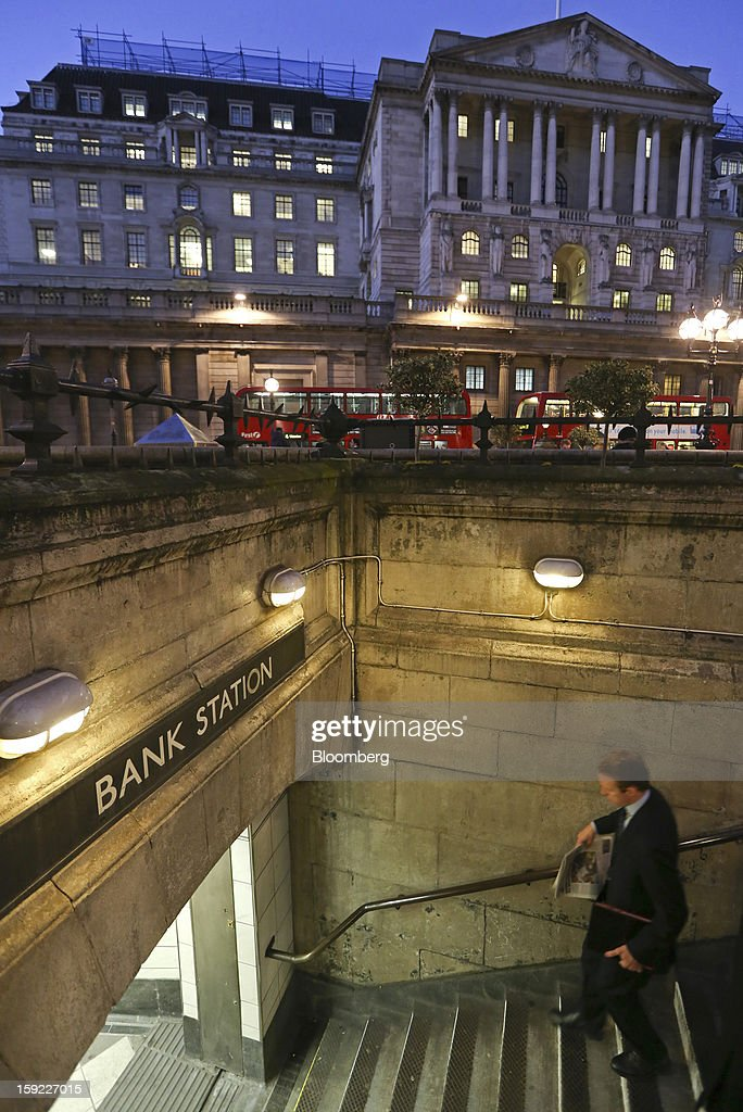 A businessman descends stairs as he enters Bank underground station near the Bank of England (BOE), center, in London, U.K., on Wednesday, Jan. 9, 2013. Bank of England policy makers will probably refrain from adding further stimulus to the U.K. economy today as their new credit-boosting program shows early signs of success. Photographer: Chris Ratcliffe/Bloomberg via Getty Images