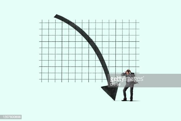 businessman despondent about declining trend - bear market stock pictures, royalty-free photos & images