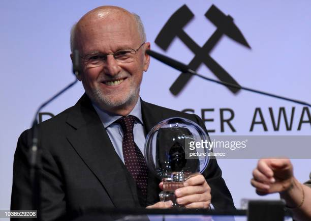Businessman Dirk Rossmann standing on stage holding the award of the category 'Charity' at the 'Steiger Awards' in Dortmund Germany 25 March 2017...