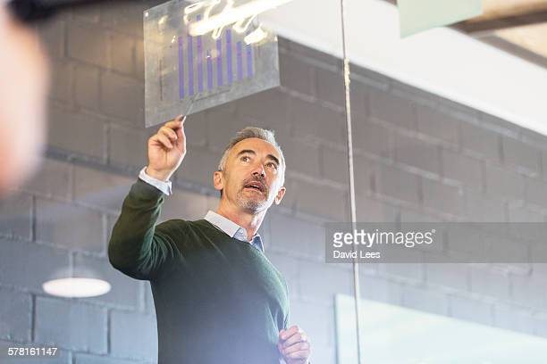 Businessman discussing graph in meeting