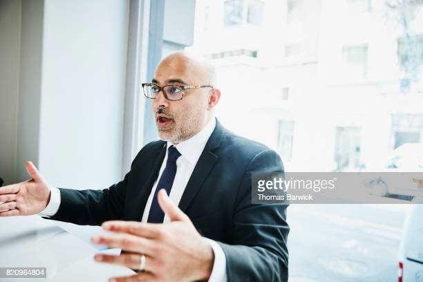 Businessman discussing project during lunch meeting in cafe