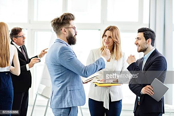 Businessman  discussing project with colleagues in office