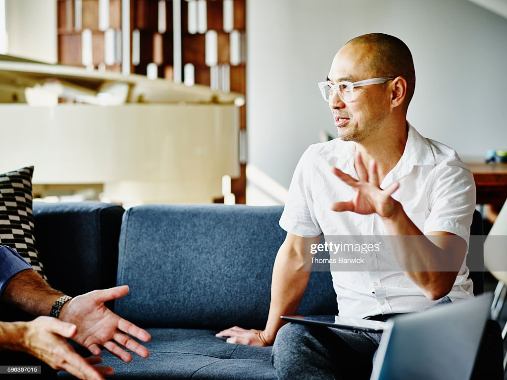 Businessman discussing project with coworker : Stock Photo