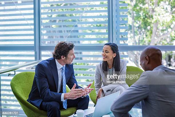Businessman discussing strategy with colleague