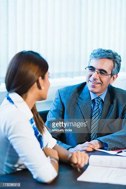 Businessman discussing with a businesswoman