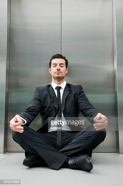 Businessman distressing with yoga pose
