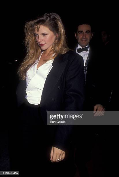 Businessman Dodi AlFayed and Tracy Lynn attend Swifty Lazar Oscar Party on March 25 1991 at Spago Restaurant in West Hollywood California