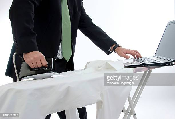 Businessman does ironing