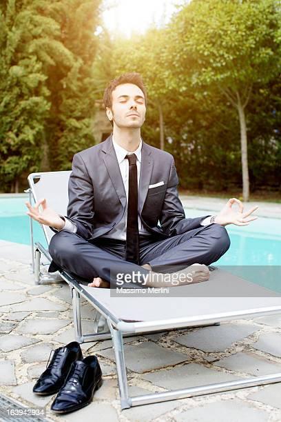 Businessman does yoga