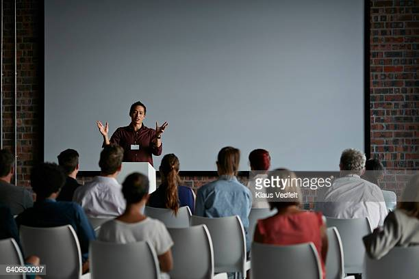 businessman doing a presentation at big convention - projection screen stock pictures, royalty-free photos & images