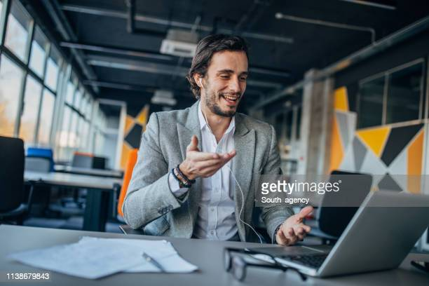 businessman doing a video call - webinar stock photos and pictures