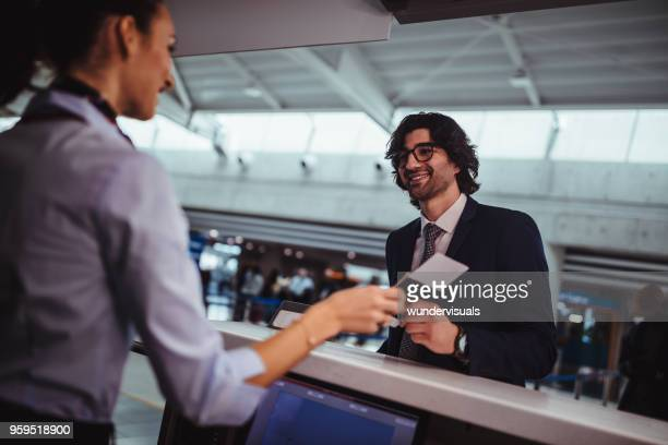 Businessman doing check-in and getting boarding pass at airport