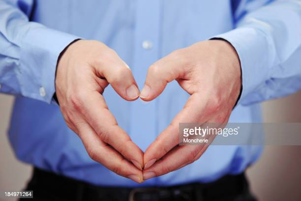 Businessman doing heart shape with his hands