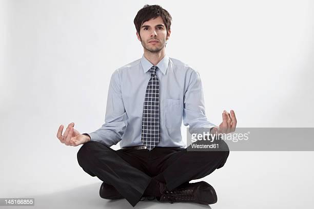 Businessman doing meditation, portrait