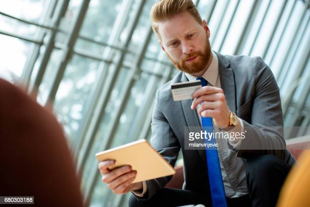 businessman doing online purchasing - phone message stock pictures, royalty-free photos & images