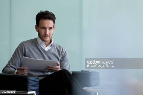 businessman doing paperwork - mission statement stock photos and pictures