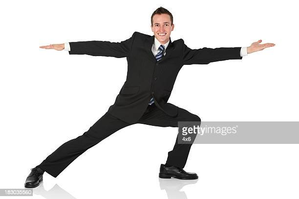 Businessman doing stretching exercise