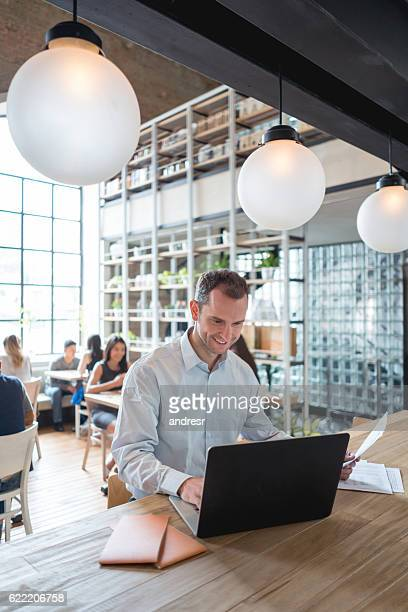 Businessman doing the books at a restaurant
