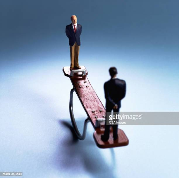 Businessman Dolls on Seesaw