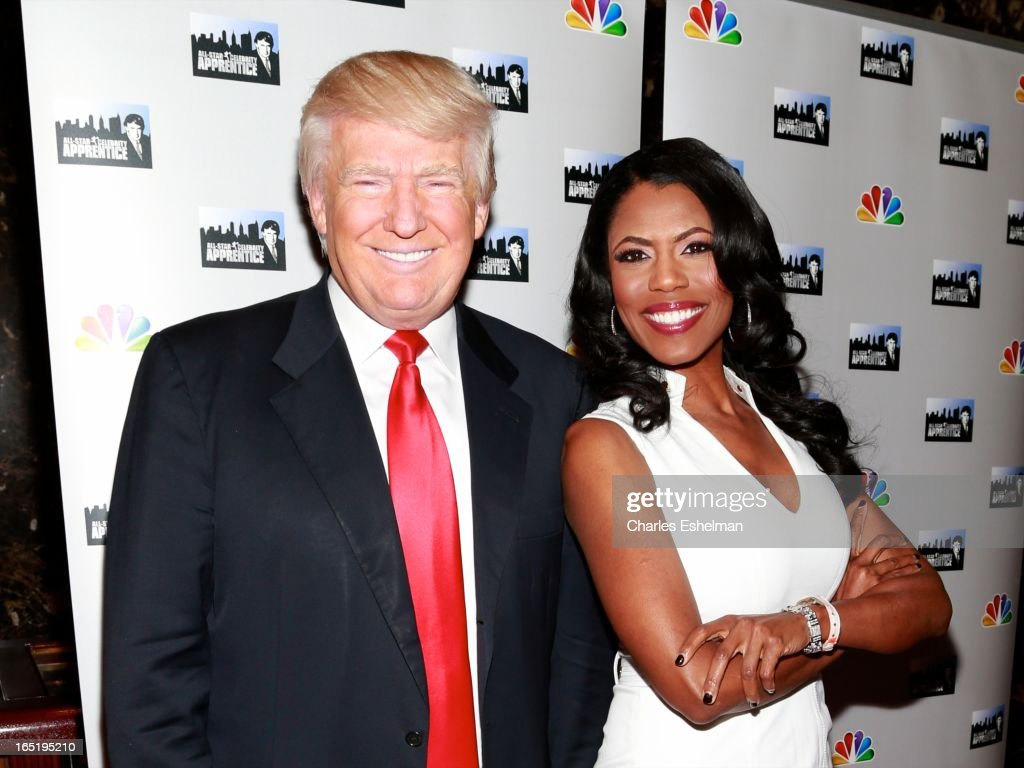 Businessman Donald Trump and actress Omarosa Manigault attend the 'All-Star Celebrity Apprentice' Red Carpet Event at Trump Tower on April 1, 2013 in New York City.