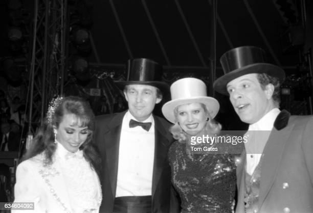 Businessman Donald Trump and his wife Ivana Trump attend 1001 Nights at the Big Apple Circus with ringmaster Paul Binder on November 161987 in New...