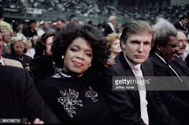 Businessman Donald Trump and Oprah Winfrey ringside at Tyson vs Spinks Convention Hall in Atlantic City New Jersey June 27 1988