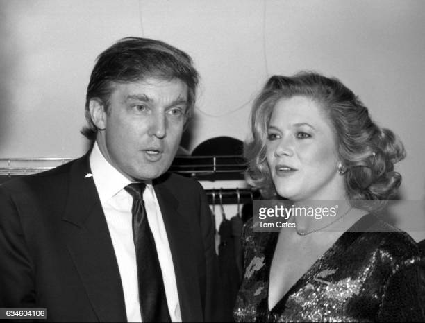 Businessman Donald Trump chats with actress Kathleen Turner at the DW Girffith Awards At Lincoln Center Library in February 1988 in New York New York