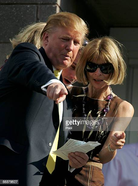 Businessman Donald Trump gives directions to the editorinchief of Vogue Magazine Ana Wintour during the men's final between Andre Agassi and Roger...