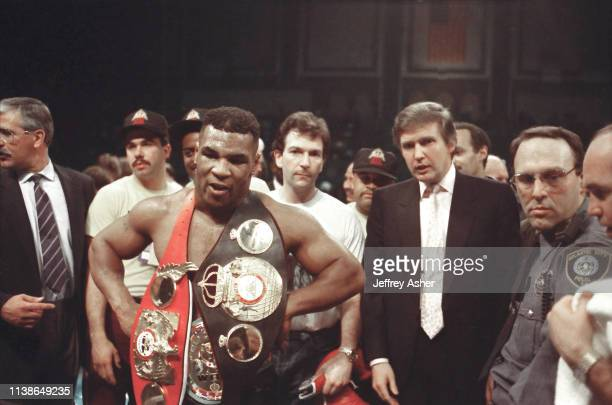 Businessman Donald Trump in ring with boxer Mike Tyson after knocking out opponent Larry Holmes at Tyson vs Holmes Convention Hall in Atlantic City...