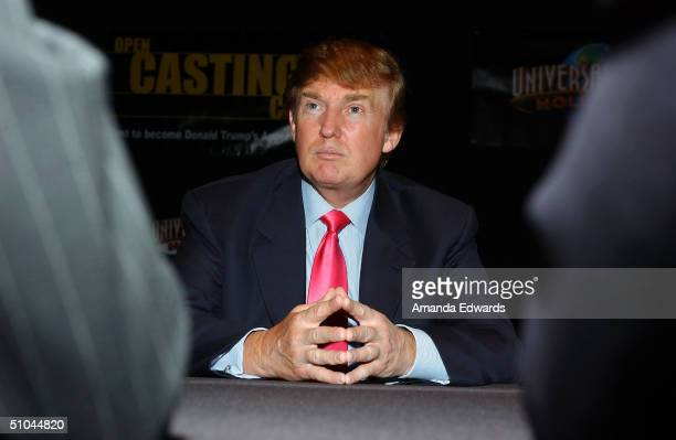 Businessman Donald Trump listens as potential contestants discuss their opinions on the first stop of the 16 city The Apprentice Recruiting Tour on...