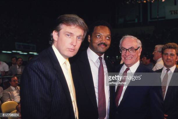 Businessman Donald Trump Minister Jesse Jackson and entrepreneur Malcolm Forbes ringside at Tyson vs Holmes Convention Hall in Atlantic City New...