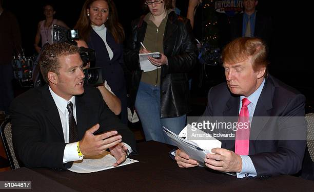 Businessman Donald Trump reads through potential contestant Ryan Mickle's application on the first stop of the 16 city The Apprentice Recruiting Tour...