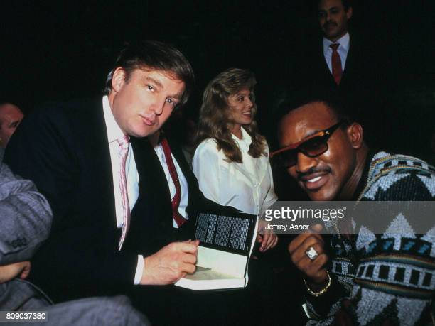 Businessman Donald Trump signs his book The Art Of The Deal for Boxer Evander Holyfield Mistress Marla Maples ringside at Tyson vs Williams...