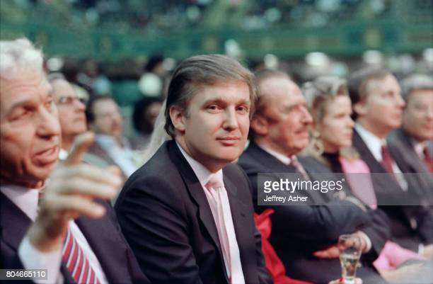 Businessman Donald Trump sitting near father Fred Trump ringside at Tyson vs Holmes Convention Hall in Atlantic City New Jersey January 22 1988