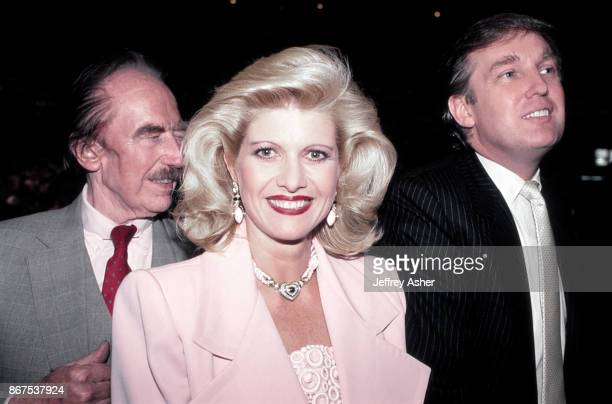 Businessman Donald Trump with Father Fred Trump and first wife Ivana ringside at Tyson vs Holmes Convention Hall in Atlantic City New Jersey January...