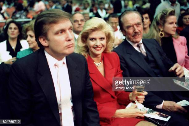 Businessman Donald Trump with first wife Ivana and father Fred Trump ringside at Tyson vs Holmes Convention Hall in Atlantic City New Jersey January...