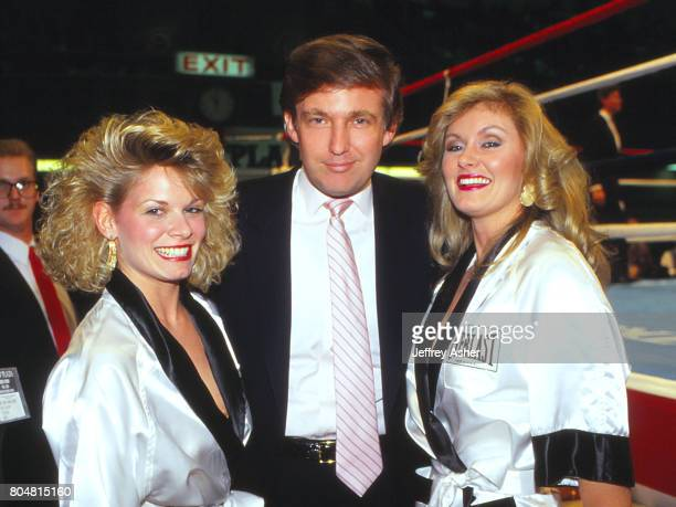 Businessman Donald Trump with round girls ringside at Tyson vs Spinks Convention Hall in Atlantic City New Jersey June 27 1988