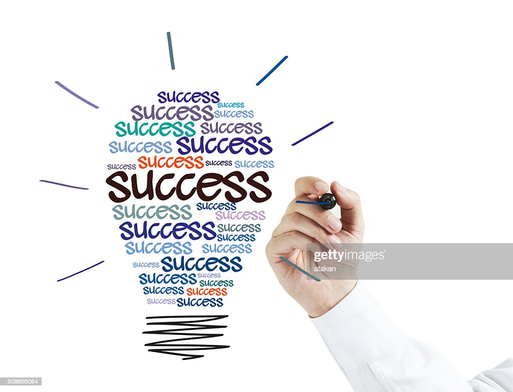 Businessman Drawing a success Idea Bulb : Stock Photo