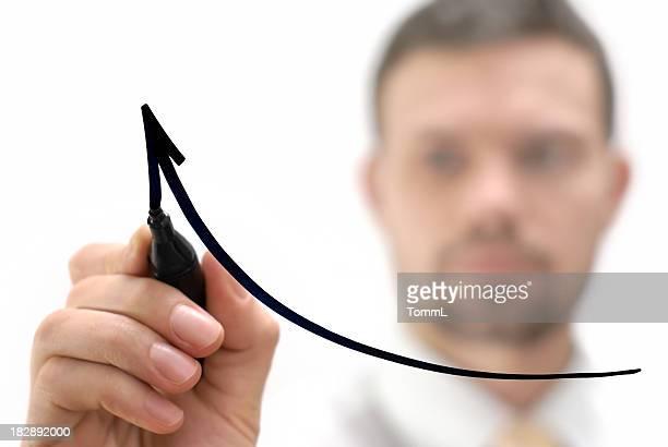 businessman drawing graph